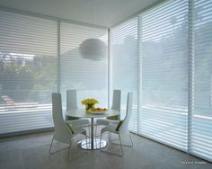 Soft fabric shades available for windows, bay windows, very large windows, french doors, remote control, and even in specialty shapes.  There is also a beautiful vertical coordinated product, Luminette for vertical applications like sliding glass doors.