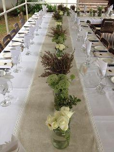 Pretty mason jars, wild flowers, lace-lined runners - wedding decor