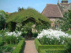 Sissinghurst Castle Gardens - love the flowers inside boxwood beds