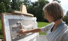 Abigail Tulis has spent the summer sculpting molds for three panels depicting dachshunds at rest and at play. The panels were commissioned b...