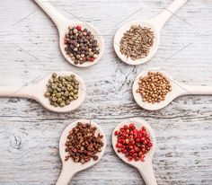 Spices Photos Six spoons of spices like circle on old wooden board by Grafvision photography
