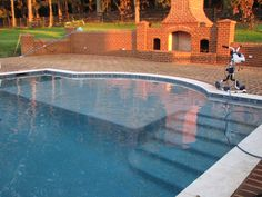 Pools Gunite Swimming Pools With Building Bricks Create A Place To Play And Create A Clean Outdoor Also A Long Broom As Well As The Outside Shape Of The Beautiful Garden Reasons of Choosing Gunite Swimming Pools
