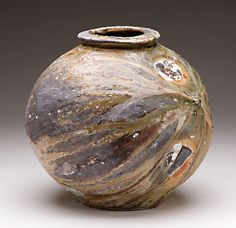 Jack Troy....there's something about pottery...so earthy and hands on (lori)