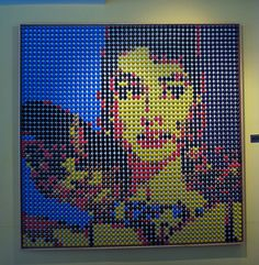 Mosaic portrait of Audrey Hepburn with Nespresso capsules