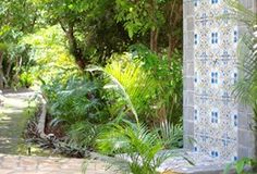 Tropical outdoor shower with Granada tiles. Spanish tiles, palm trees, tropical plants, path and landscaping in playa colorado, Hacienda Iguana, Nicaragua, Central America