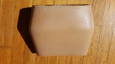 For sale: Russel Wright Bauer PILLOW VASE (centerpiece and jug vase are SOLD!) in the Atlanta Brick glaze. In great condition with no cracks, just several popped bubbles in the glaze, as happened all the time with this line - the worst culprit is pictured.  Please ask any questions you may have - and, check out the rest of our awesome Russel Wright and other MCM items for the home