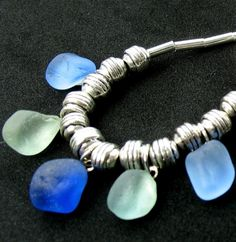 This glistening sea glass necklace was handmade with genuine, hand picked seaglass beachcombed by me from a shore along the majestic Pacific Ocean shoreline. It features a 5 piece mix of aqua blue, cornflower blue and light cobalt. Sea Glass Necklace, Sea Glass Jewelry, Jewel Of The Seas, Nautical Bracelet, Sea Glass Crafts, Pacific Ocean, Metal Beads, Driftwood, Pendant