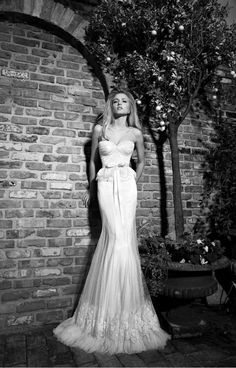 oh my - love the delicate peplum detail on this wedding dress