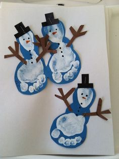 Footprint Snowmen - a bit more complex but very effective! Paint feet white and stamp onto blue card. Cut around the print and wait to dry. Stick onto white card and add arms (pipe cleaners or just paint on), black top hat and eyes, nose, buttons etc. Job done!