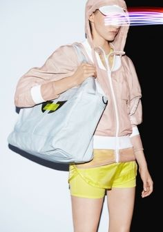 love the palette and the overall sense of proportions. yellow shorts and a skin-tone hoodie. Plus the oversize bag, of course.