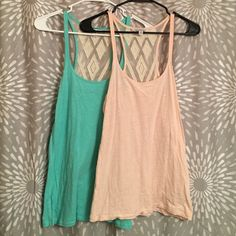 Teal and light pink bundle! Two shirts for the price of one! These American Eagle tank tops are great for the summer time. They have a sheer cut out in the back which is so cute!! Both are a size M! American Eagle Outfitters Tops Tank Tops