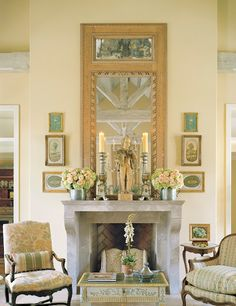Tall mirror flanked by symmetrical prints. Symmetrical decor on mantel--coordinated w/prints & mirror frame.