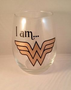 A personal favorite from my Etsy shop https://www.etsy.com/listing/472712022/wonder-woman-stemless-wine-glass-proud
