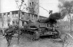 A Soviet soldier is passing by the destroyed german tank, Panzer IV(F), in Battle of Starlingrad. by gorekun, via Flickr