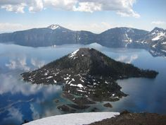 Located at the west end of Crater Lake, in Oregon's Crater Lake National Park, you will find this amazing volcanic cinder cone aptly known as Wizard Island. The top of the island reaches 6,933 feet (2,113 m) above sea level and soars roughly 755 feet (230 m) above the surface of the lake. The cone is capped by a volcanic crater about 500 feet (150 m) wide and 100 feet (30 m) deep