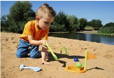 Haba's new Baudino Sand Golf game for kids - theholes are buried in the sand.
