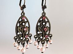 $38  Romantic, elegant, Victorian inspired floral earrings. Swarovski crystals and pearls give it a classic, timeless style. True old-world charm!