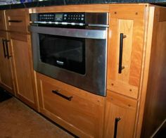 Microwave drawer, retrofitted with sideways drawers. Drawers have bungees inside to hold wraps,etc.