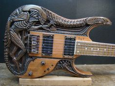 Carved Alien Guitar by Gig Goldstein I keep coming across some amazing carved guitars and this one is a beauty, I like the control knobs representing the Alien eggs ready to hatch.