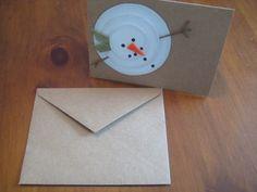 Laissez à la main de cartes de Noël bonhomme de neige
