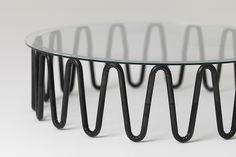 interior design Bardsley uses wrinkled steel tubes for essenze furniture collection