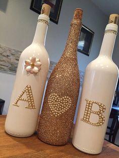 Rose Gold and White wedding wine bottle centerpieces- Bespoke Rose G . Rose Gold and White wedding wine bottle centerpieces- Bespoke Rose Gold and white monogrammed wine bottle set. Glass Bottle Crafts, Wine Bottle Art, Painted Wine Bottles, Diy Bottle, Vodka Bottle, Glitter Wine Bottles, Bottle Labels, Beer Bottle, Wine Bottle Centerpieces