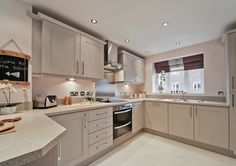 Taylor Wimpey - The Lavenham at Marston Grange, Beaconside, Stafford Kitchen/Dining Room ideas using pale grey / dove grey and oyster shades Kitchen Family Rooms, New Kitchen, Kitchen Dining, Kitchen Decor, Dining Room, French Kitchen, Kitchen Ideas, Wimpey Homes, New Home Developments