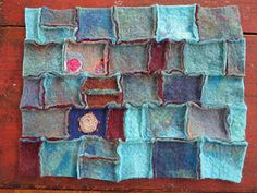 bleu felt with small embroidery