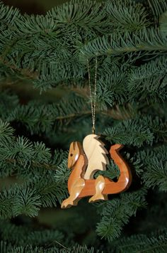 Wood carving Christmas ornaments | DRAGON CHRISTMAS ORNAMENT Wood Carving. Whimsical yet festive, a ...