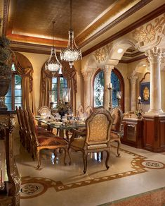opulent dining room~ like the columns, arches, ceiling & window treatments
