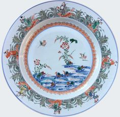 """A Chinese export porcelain doucai """"mandarin ducks"""" charger. Kangxi period. China/Asia. Painted and gilt with a central medallion depicting mandarin ducks in a lotus pond, within a border of the Eight Daoist Immortals riding upon mythical beasts amongst foaming waves."""