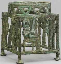 Ceremonial bronze stand, possibly Kourion, Cyprus, 13th-12th century B.C.  Shows a man carrying an oxhide ingot towards a tree, and another playing a lyre, hints at close relationship betwen copper production and elite ritual on Cyprus. British Museum