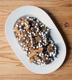 Mix Golden Grahams cereal, dark chocolate, mini marshmallows, and a sprinkling of salt, and you have s'mores snack mix, a campfire-free, car-friendly version.