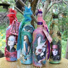 Alice Through the Looking Glass mixed media bottles using DecoArt's Metallic Lustre!  Love the stuff!