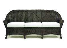 Closed Weave Wicker Sofa Expand seating options in sunrooms or other indoor spaces with ever-popular wicker. Featuring a fine-tooth in the closed-weave design, this generously sized sofa adds the unpretentious comforts of flared armrests with a gentle roll that rides upward along the back. At the front, braided trim sits just above arching aprons with added support from additional framing marked by wrapped feet.