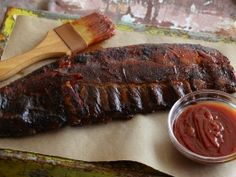 The Ultimate Barbecued Ribs from CookingChannelTV.com...a great recipe to oven bake them with peach/Dijon/molasses/brown sugar/thyme/onion/garlic/paprika/ketchup/cumin/white wine vinegar/olive oil/bacon...then finish on the grill.