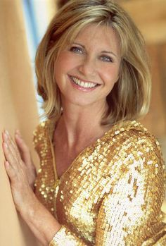 Olivia Newton-John, an English born singer and actress. Four time Grammy award winner. Her music: pop, country and adult contemporary.