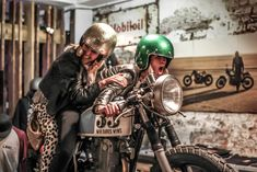 2 girls joking around on a cafe racer, open face glitter helmets :: free the wheels :: Biltwell