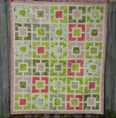 love this quilt with the green and coral colors - this blog links to another blog with the tutorial
