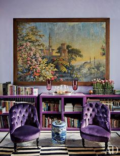 Arrayed in the living room of a Beirut home are an antique toile peinte, custom-made lacquer bookcases, and a pair of vintage chairs.