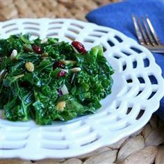 "Kale Cranberry Pepita Salad | ""This is a modified version of a national grocery chain's kale salad. It's a delicious way to eat your greens! You can substitute sesame seeds for the pepitas."" - sydneyt"