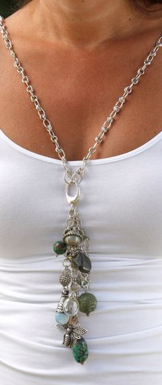 necklace, with interchangeable drop charm.  Note the lobster claw at the front for an attachment. Good way to use orphan beads