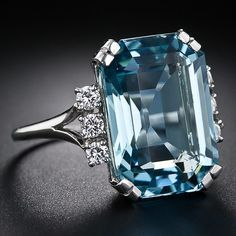 A richly saturated emerald-cut aquamarine weighs about carats (but presents considerably larger due to masterful lapidary work), is embellished on each side by a sparkling trio of round brilliant-cut diamonds in this superb and impressive bauble, ha Emerald Cut Aquamarine Ring, Aquamarine Jewelry, Blue Topaz Ring, Antique Aquamarine Ring, I Love Jewelry, Jewelry Design, Piercing Septum, Antique Jewelry, Vintage Jewelry