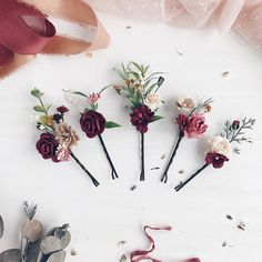 Set of 5 hair bobbi pins with burgundy, ivory, white flowers, babys breath and greenery. Matching wrist corsage https://www.etsy.com/listing/560594565/burgundy-flower-wrist-corsage-fall-wrist https://www.etsy.com/listing/540431639/fall-wedding-burgundy-flower-wrist Matching boutonniere