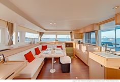 Lagoon 450 FlyBridge Kat Marina The saloon: a warm and spacious living room, bathed in natural light.