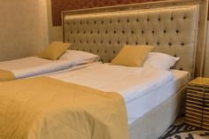 Yellow bedspread and pillows.