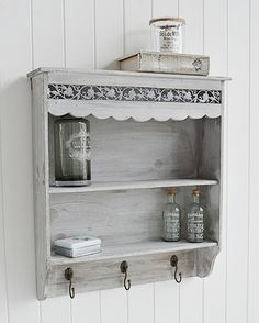 Grey wall shelf with hooks from The White Lighthouse