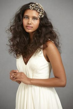 I love the simplicity of this whole look. A beautiful young woman, natural makeup, unfussy hair in a beautiful simple gown.