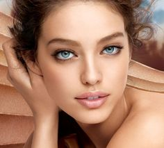 mascara and soft lipstick-brunette with light skin color and light blue eyes