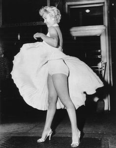 *-*  Marilyn Monroe on the set of The Seven Year Itch; filming the subway grate scene 1955